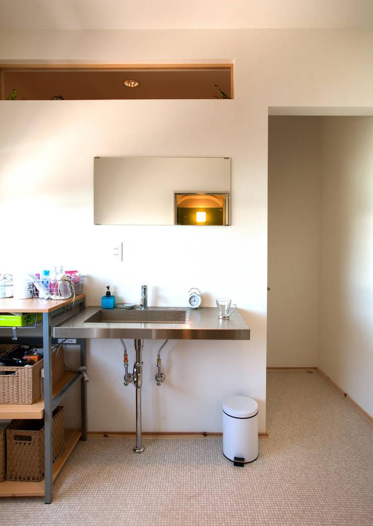 下石田のリノベーション: 藤森設計一級建築士事務所が手掛けた浴室です。