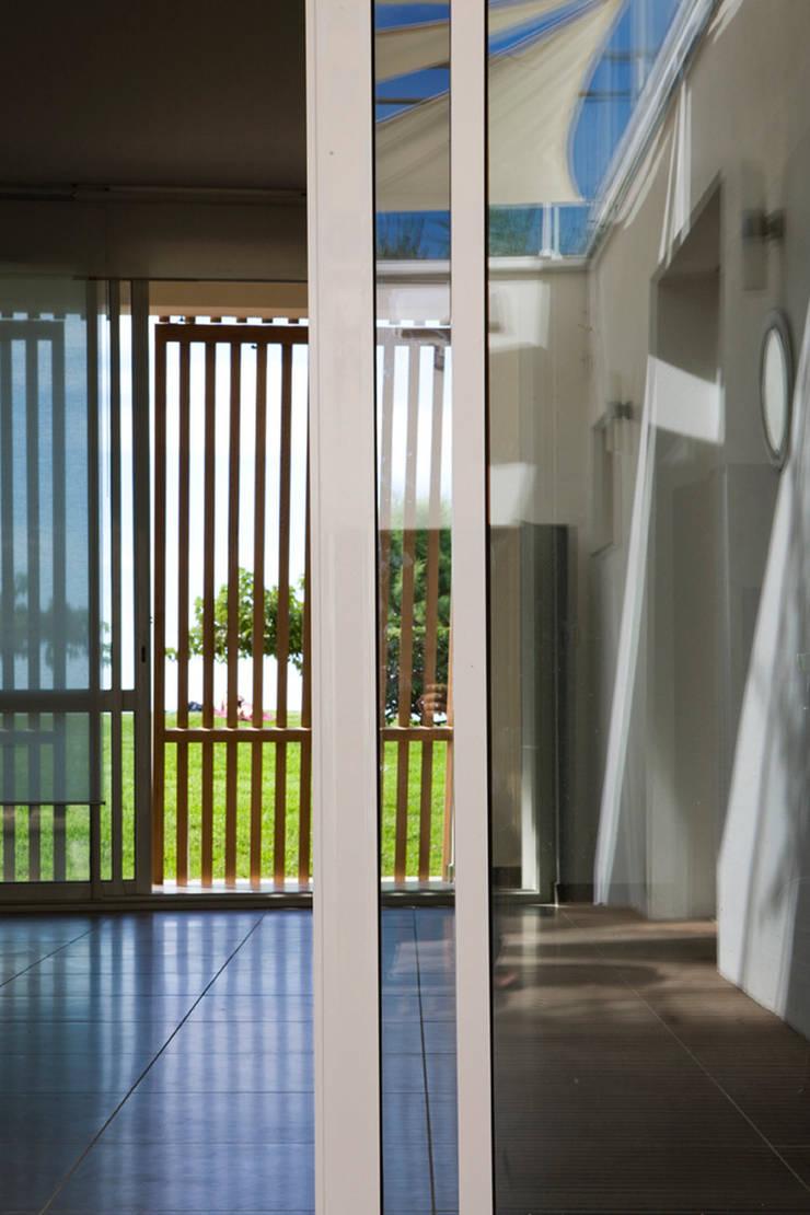 THALASSO: Maisons de style  par Florence Gaudin architecte