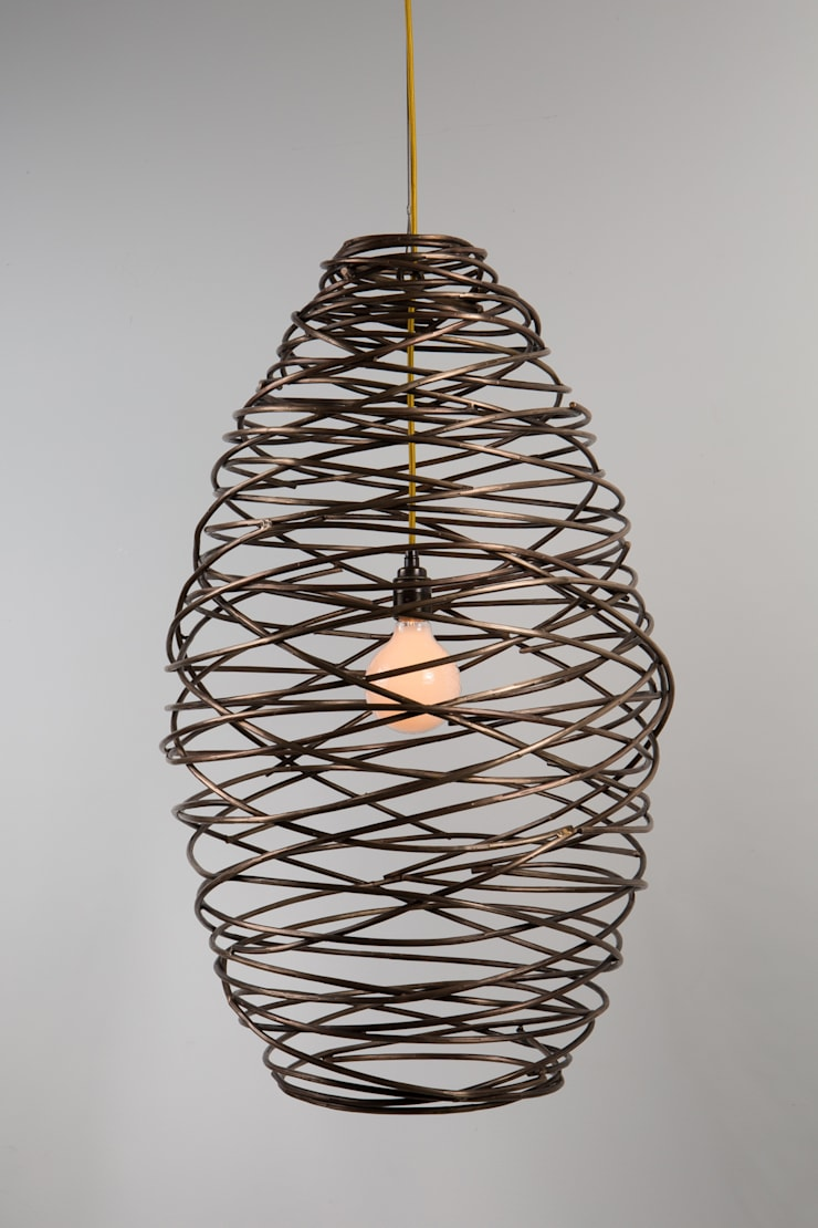 Cocoon light:  Living room by James Price Blacksmith and Designer