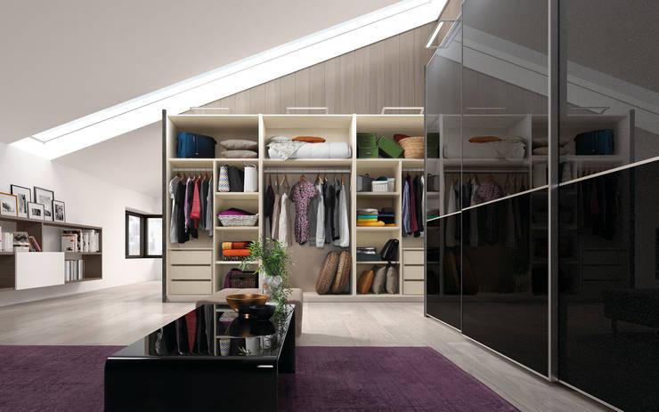 Armarios puertas correderas: Dormitorios de estilo moderno de Baixmoduls