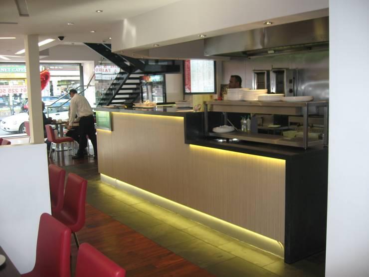 Sanam Restaurant & Banquet Hall:   by DK Architects