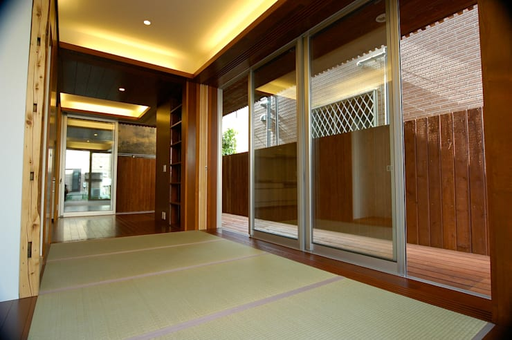 1階: 仲摩邦彦建築設計事務所 / Nakama Kunihiko Architectsが手掛けた和室です。,モダン