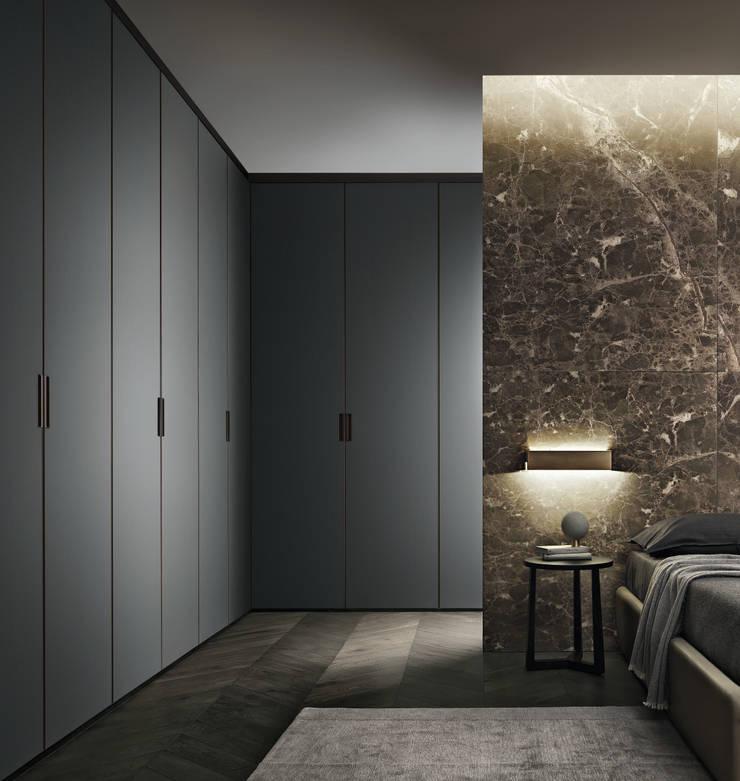 CABINE ARMADIO: Camera da letto in stile  di Rimadesio