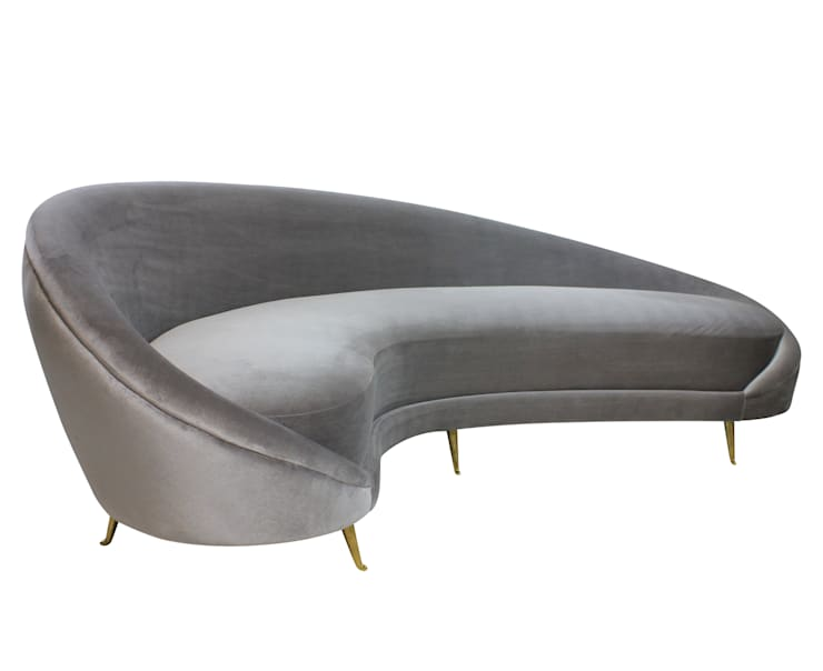 A Large Curved Sofa By Parisi:  Living room by Antiques, Lighting and The Interior