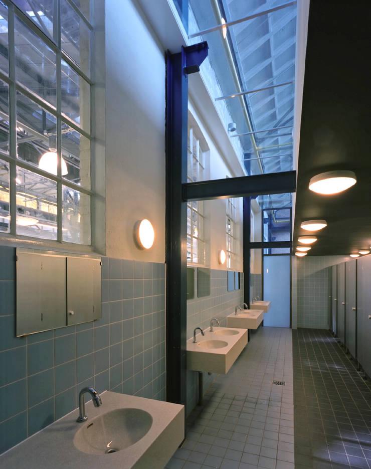Oud en nieuw:  Kantoor- & winkelruimten door Erik Knippers Architect