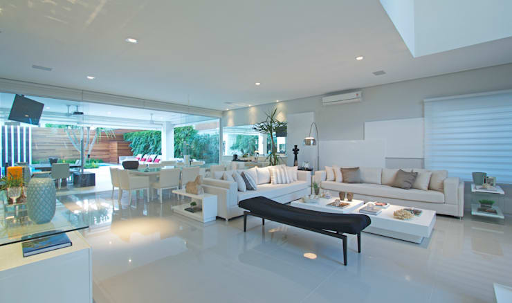 Casa de Praia: Casas  por Jóia Bergamo - Arquitetura e Design de Interiores