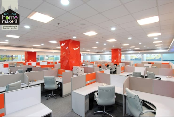 Orange Office:  Study/office by home makers interior designers & decorators pvt. ltd.