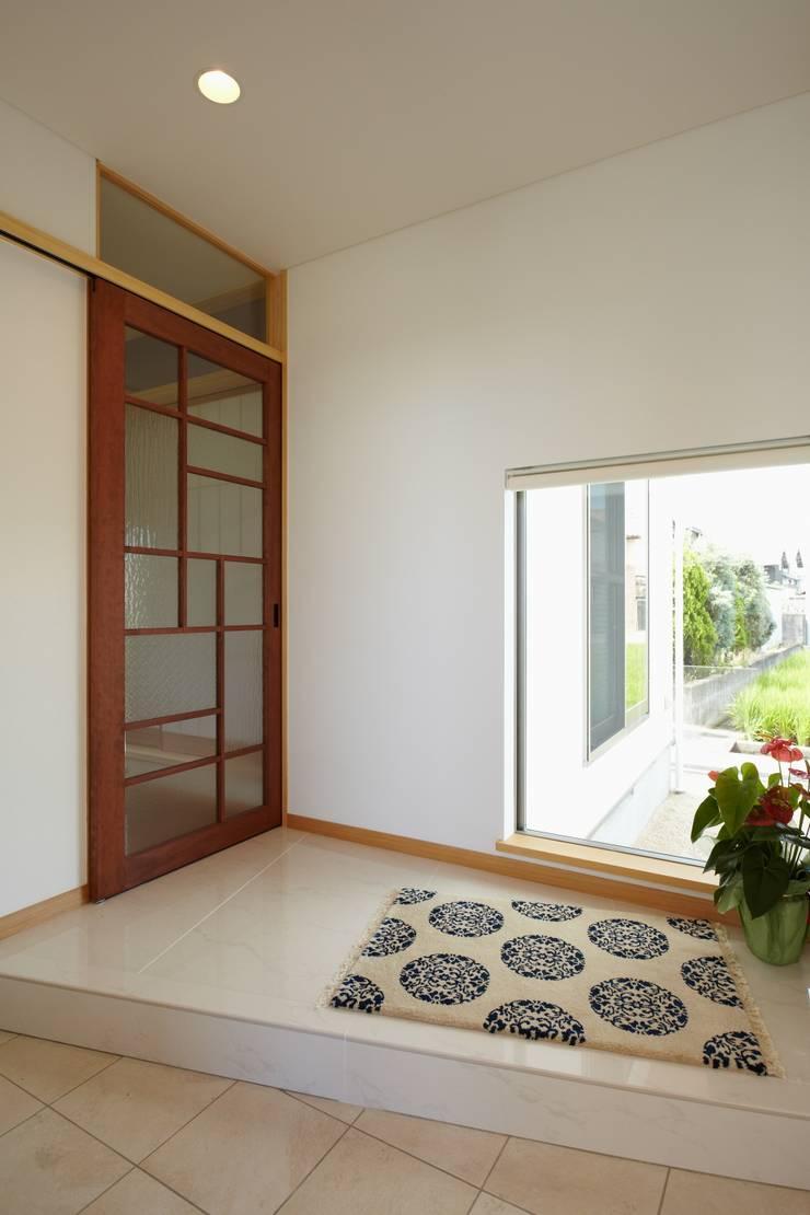 翠を望む家: ATELIER TAMAが手掛けた窓です。