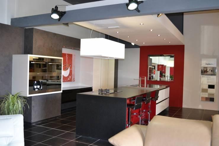 Cozinhas modernas por pur cuisines et interieur