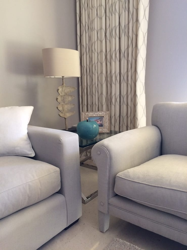 Fossil Lamps and Turquoise Apple:  Living room by Rachel Angel Design