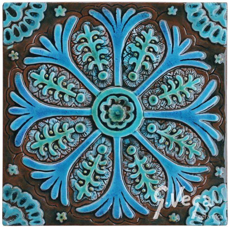 Individual wall tile based on Suzani fabric from Uzbekistan:  Walls & flooring by Gvega Ceramica