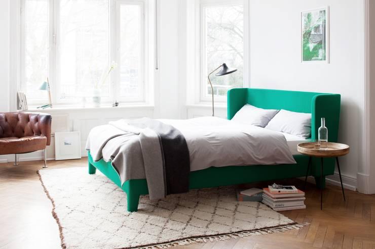Camera da letto in stile in stile Moderno di HOME Schlafen & Wohnen GmbH