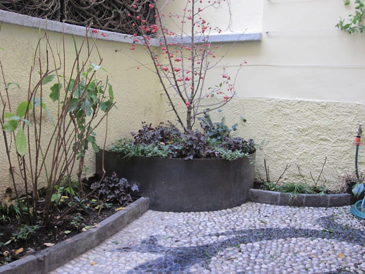 Giardino segreto: Giardino in stile  di Architettura del verde, Classico
