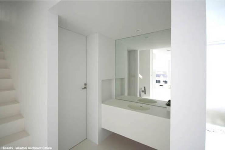 Sea Side House: 鷹取久アーキテクトオフィスが手掛けた浴室です。