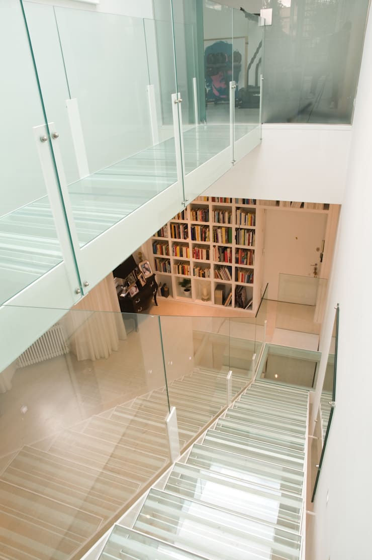 una casa piena di luce: Case in stile  di Sycamore ,