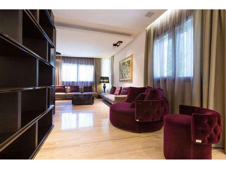 Sala lettura:  in stile  di V.Z. Architettura & Design,