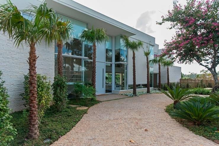 Casa 491: Casas  por Jannini & Sagarra Arquitetura
