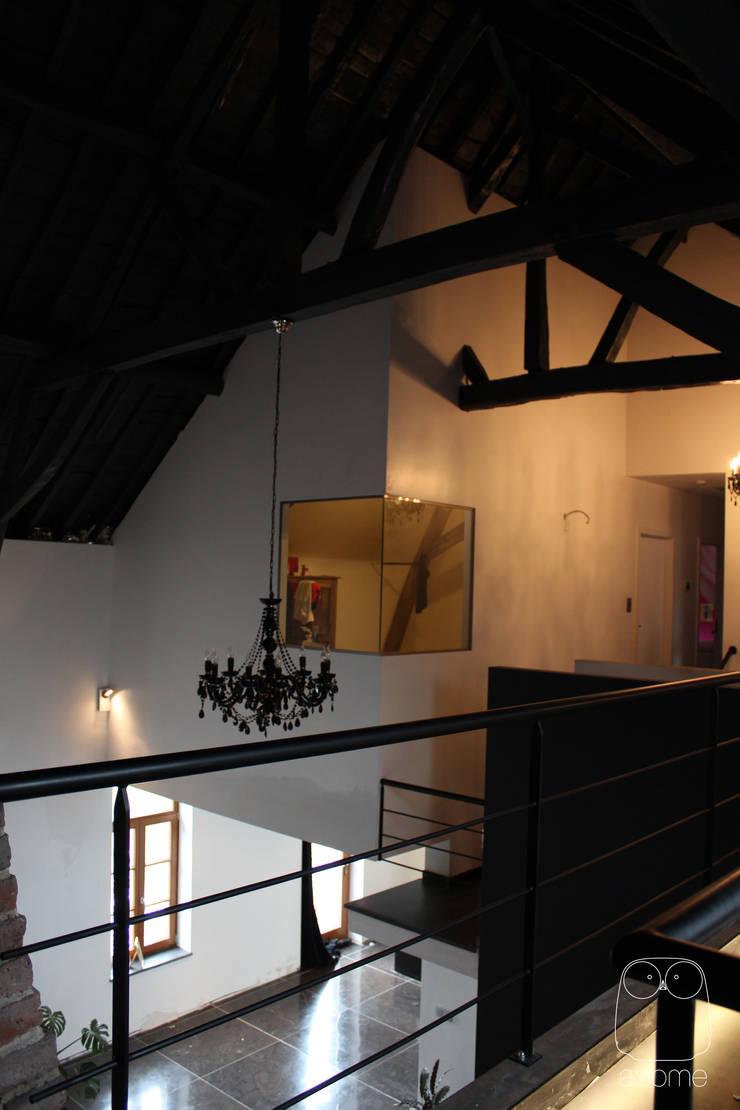 Maison DG: Maisons de style  par Axiome Architecture