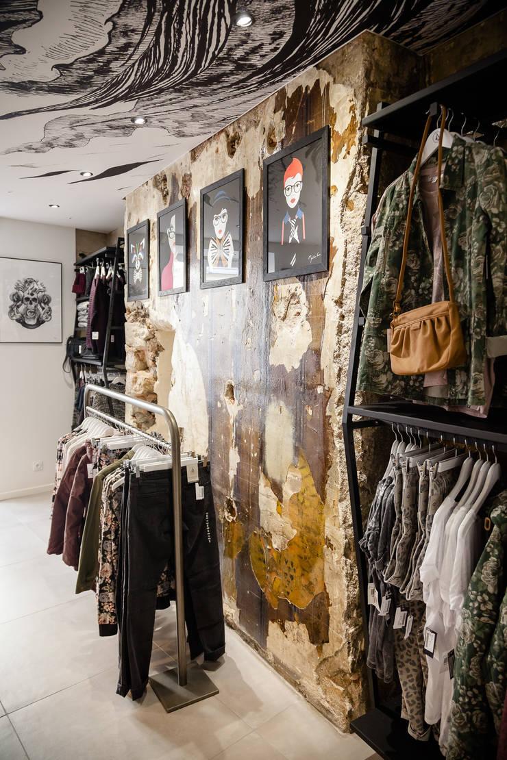 Mur original: Locaux commerciaux & Magasins de style  par CADYPSO