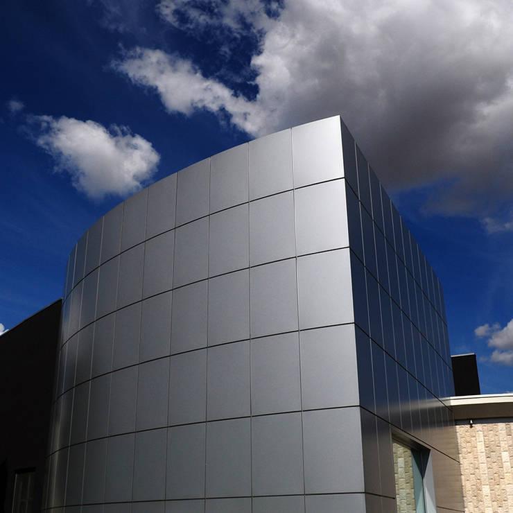 material joints - show-room arredamenti: Negozi & Locali Commerciali in stile  di pietro quatrini architetto