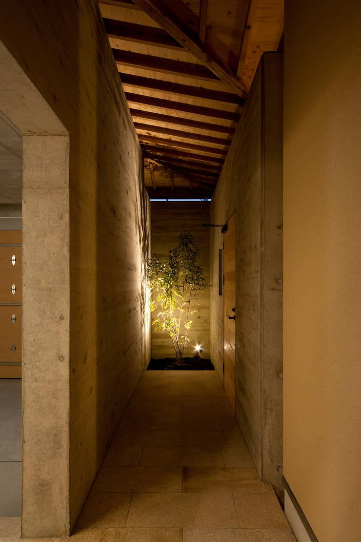 Spot garden: 一級建築士事務所 Kenso Architectsが手掛けた庭です。