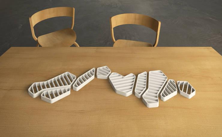 dessous de plat: Salle à manger de style  par Romain Giraud