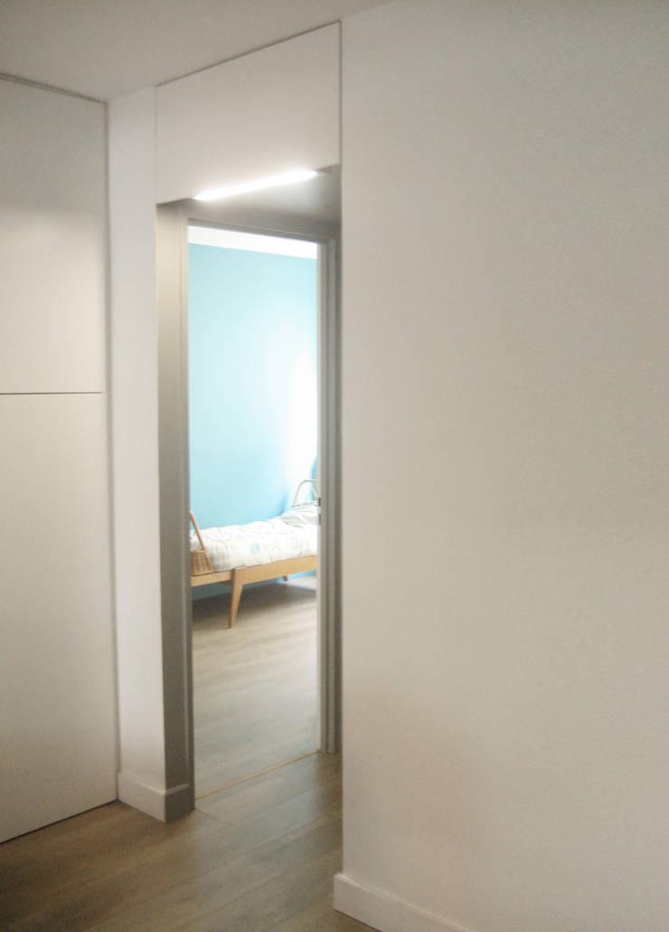 Aménagement d'un appartement 4 pièces de 65m² PARIS:  de style  par MALBRAND - ARCHITECTURES