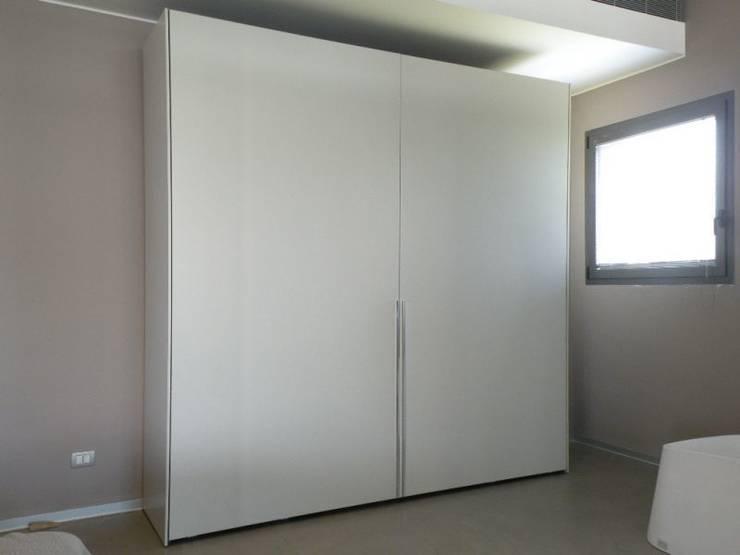 Molteni & C - Gliss: Camera da letto in stile  di Salvioni Spa