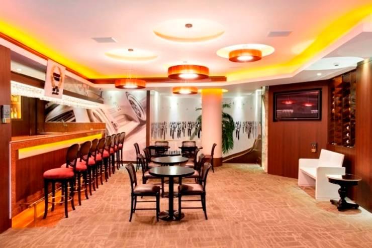 Hotel Novo Mundo - Bar Grand Prix: Hotéis  por DG Arquitetura + Design