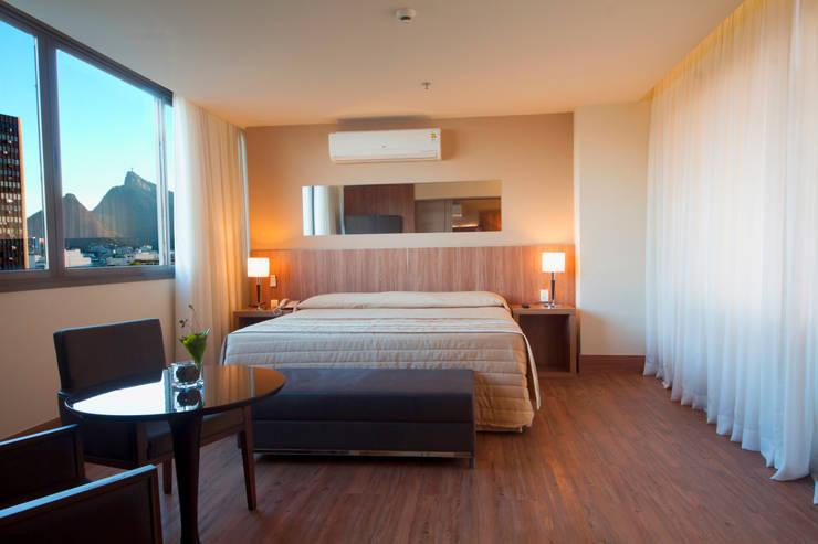 Hotel Novo Mundo - Suíte: Hotéis  por DG Arquitetura + Design
