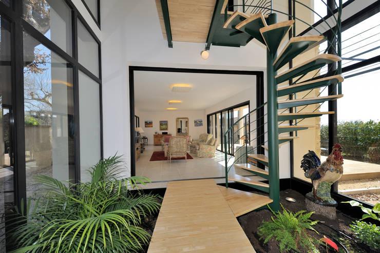 Jardines de invierno de estilo moderno por JOSE MARCOS ARCHITECTEUR