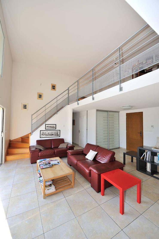 MAISON CONTEMPORAINE: Maisons de style  par JOSE MARCOS ARCHITECTEUR