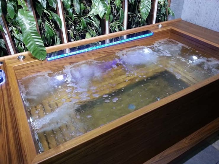 Jacuzzi with LED and wave filler: modern Spa by William Garvey Ltd