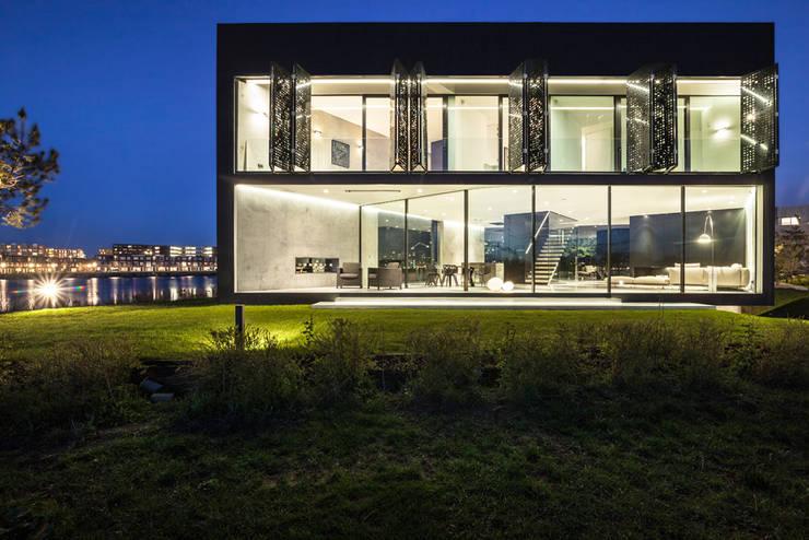 Casas de estilo moderno por Studioninedots