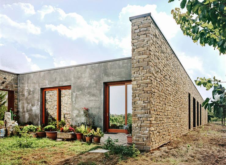casa ESSE: Case in stile  di ellevuelle  architetti,
