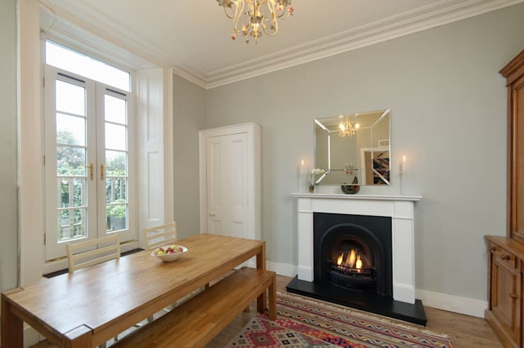 Dining Room:  Living room by Saving Graces Interiors