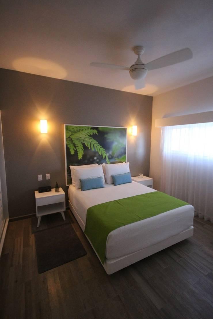 Hotel Azura Tulum: Recámaras de estilo  por axg arquitectos