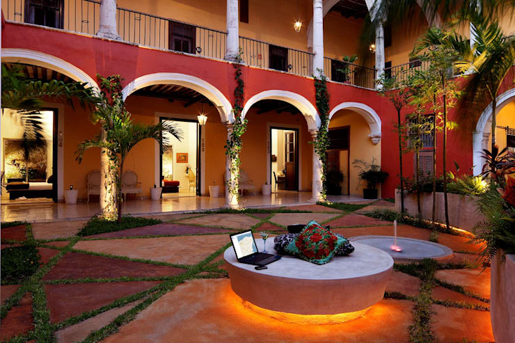 Hoteles de estilo  por Taller Estilo Arquitectura