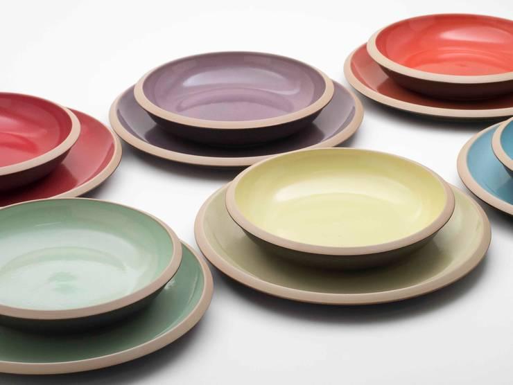 Giotto Piatti: Cucina in stile  di Ceramiche Bucci srl