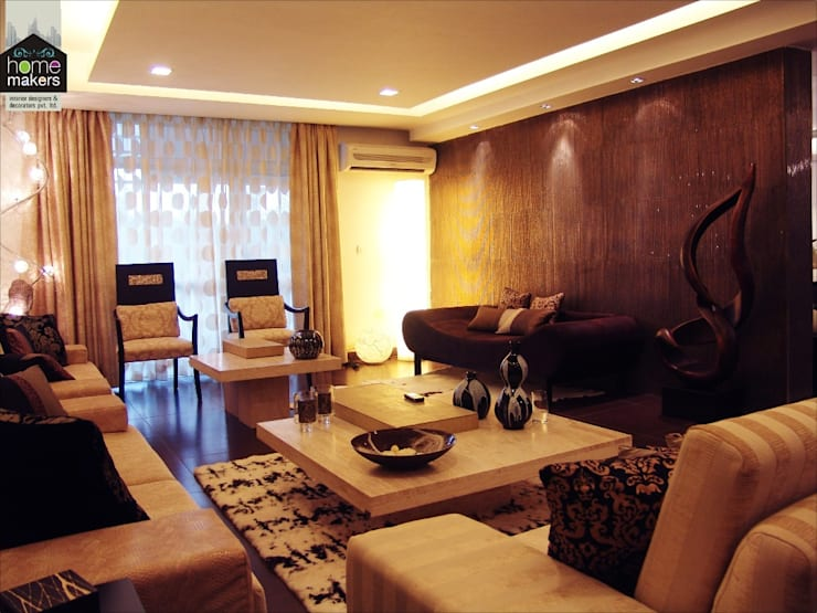 Warmth...:  Living room by home makers interior designers & decorators pvt. ltd.