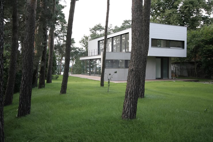 Houses by THOMAS BEYER ARCHITEKTEN, Modern