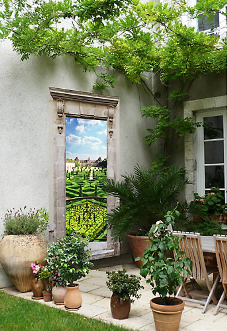 Jardin à la française: Maison de style  par Creamint