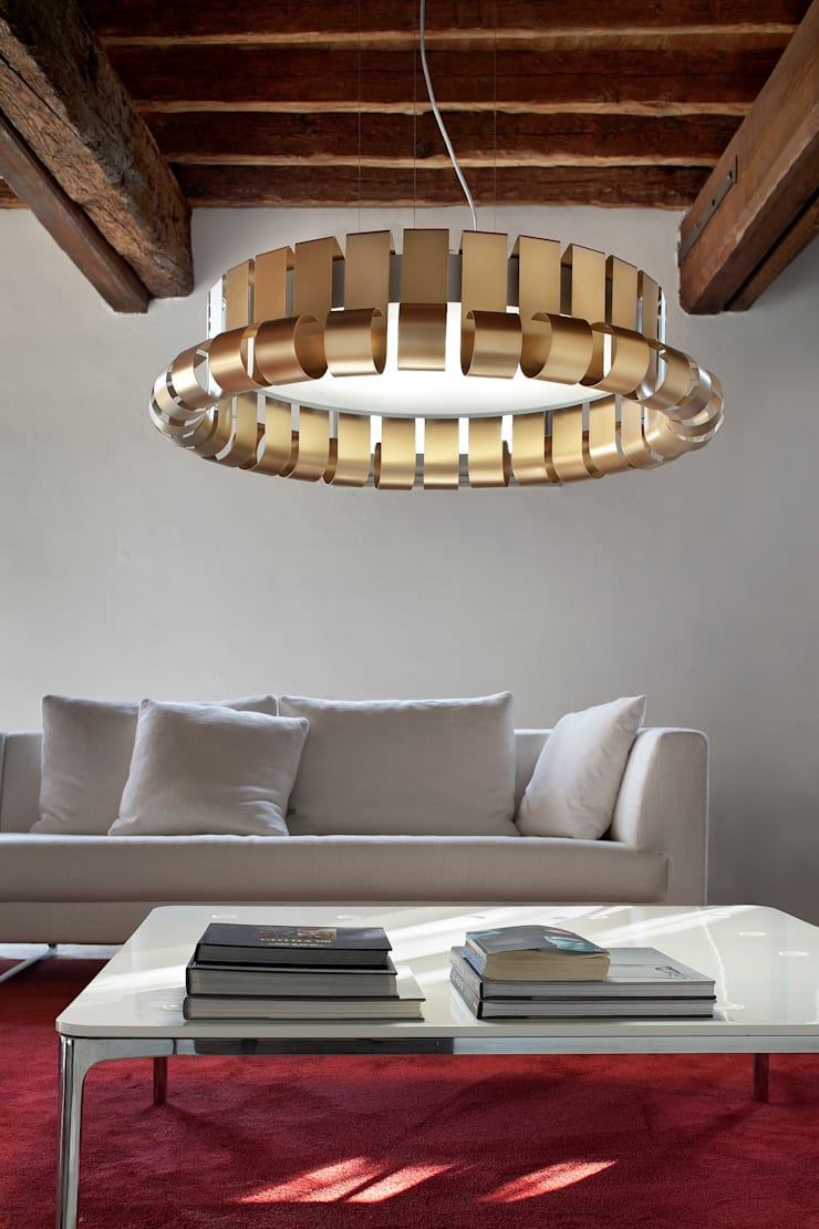 Simple, neat and stylish light. Retro or not, it shines!:  Living room by Italian Lights and Furniture Ltd