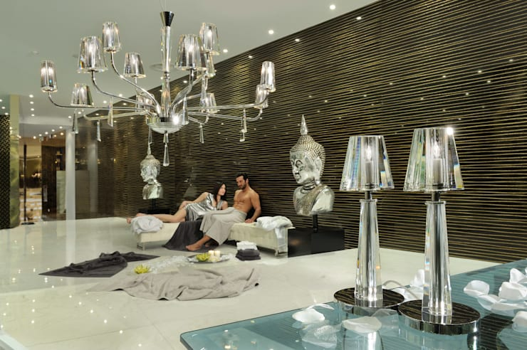 The crispness and clarity of bold Italian crystal:  Living room by Italian Lights and Furniture Ltd