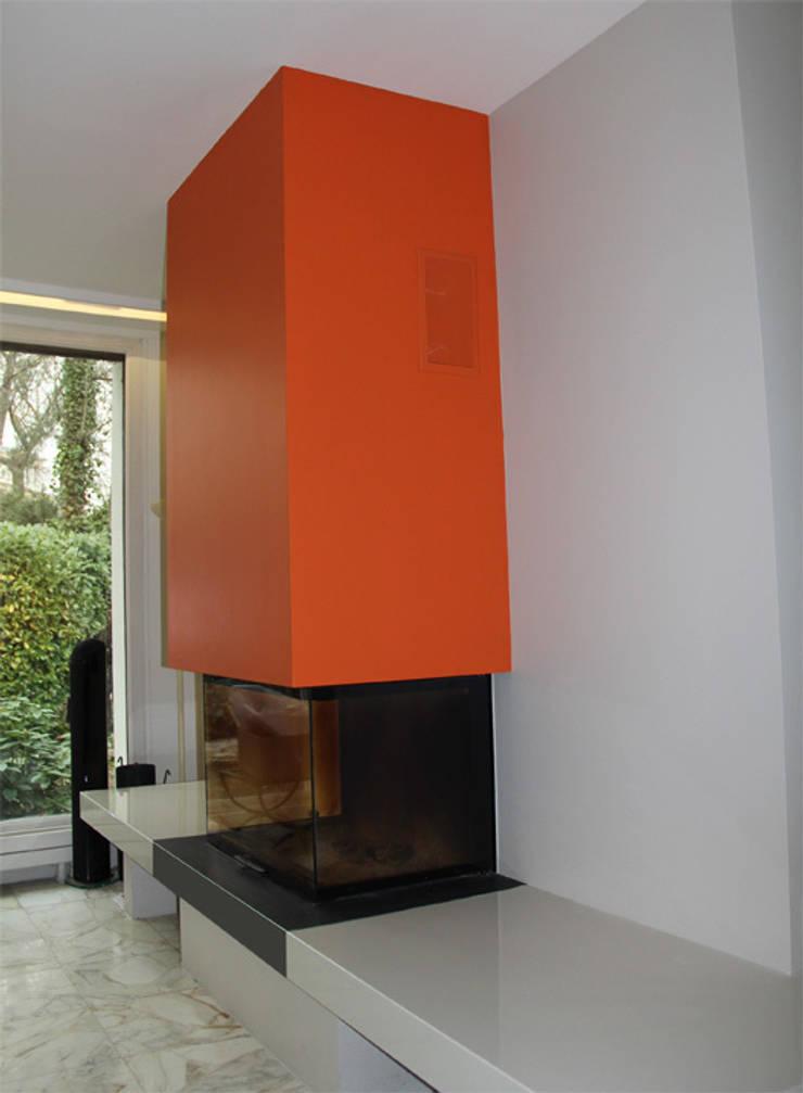 Cheminée design: Maisons de style  par Architectures²
