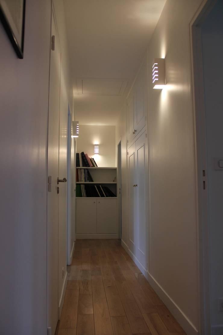 Étage chambres: Maisons de style  par Architectures²