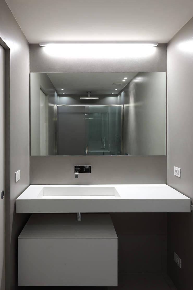 Appartamento in Piazza S.Giovanni: Case in stile  di CMT Architetti,