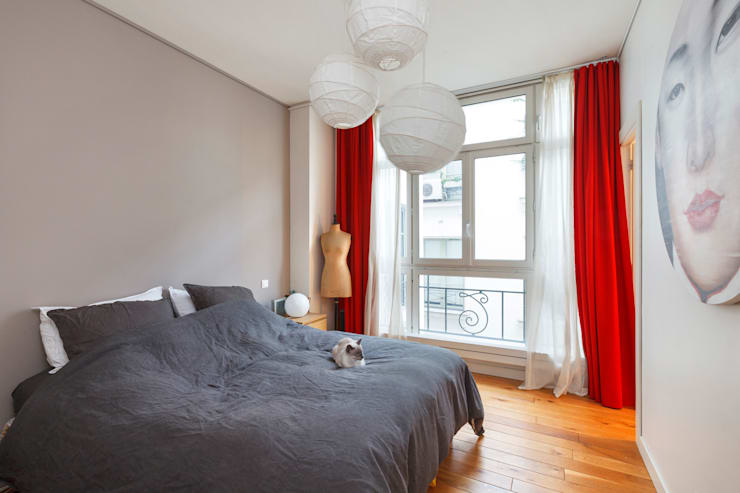 Réhabilitation d'un appartement Paris 10e 123 M²:  de style  par Marion Boinot