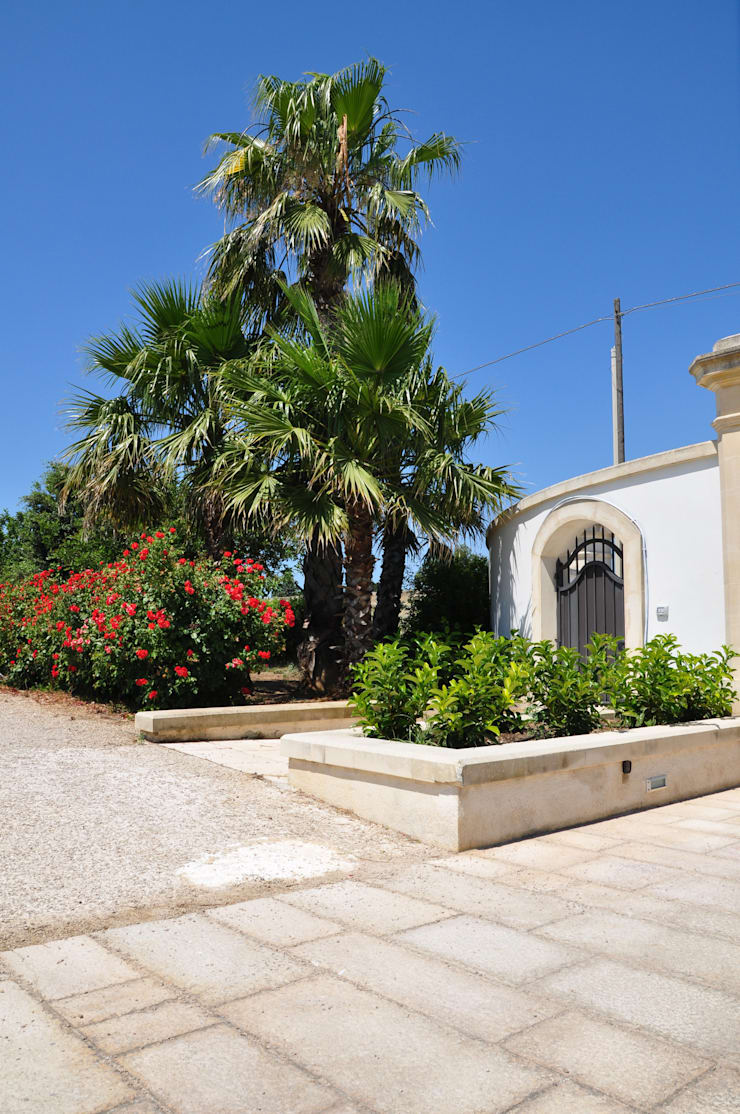 Classico contemporaneo: Giardino in stile  di  MELLOGIARDINI EXTERIOR DESIGNERS, Classico
