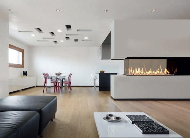Livings de estilo  por Anglia Fireplaces & Design Ltd